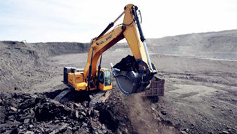 BUILD WITH POWER: SY215C EXCAVATOR USED IN TRENCHING WORK
