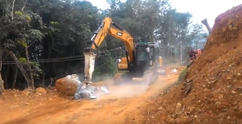 SANY 13.5 ton small excavator SY135C breaks the ground for a road construction project