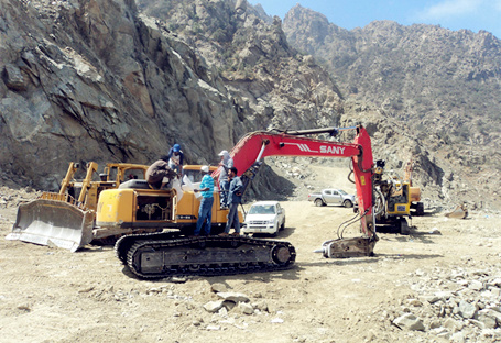 SANY medium excavator SY215C used in a winding road construction project